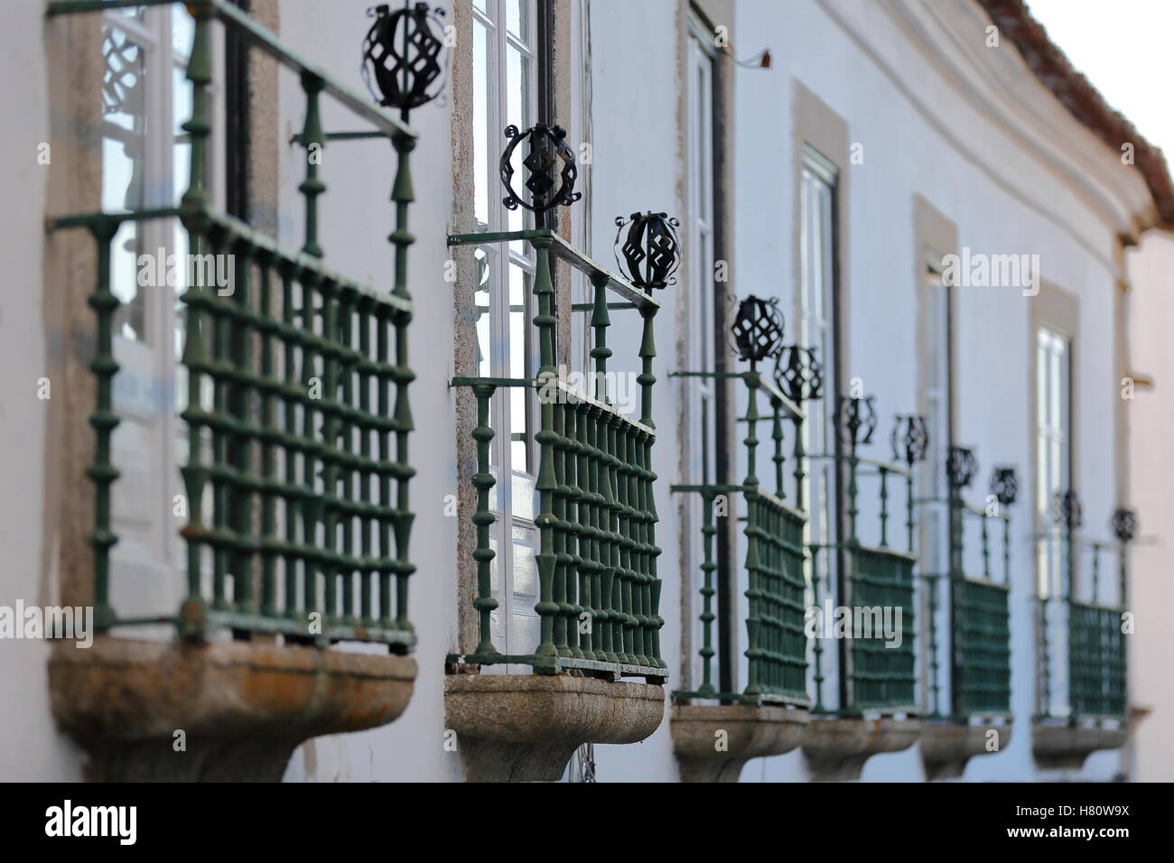 EVORA, PORTUGAL: Alignment of balconies with wrought iron railing - Stock Image
