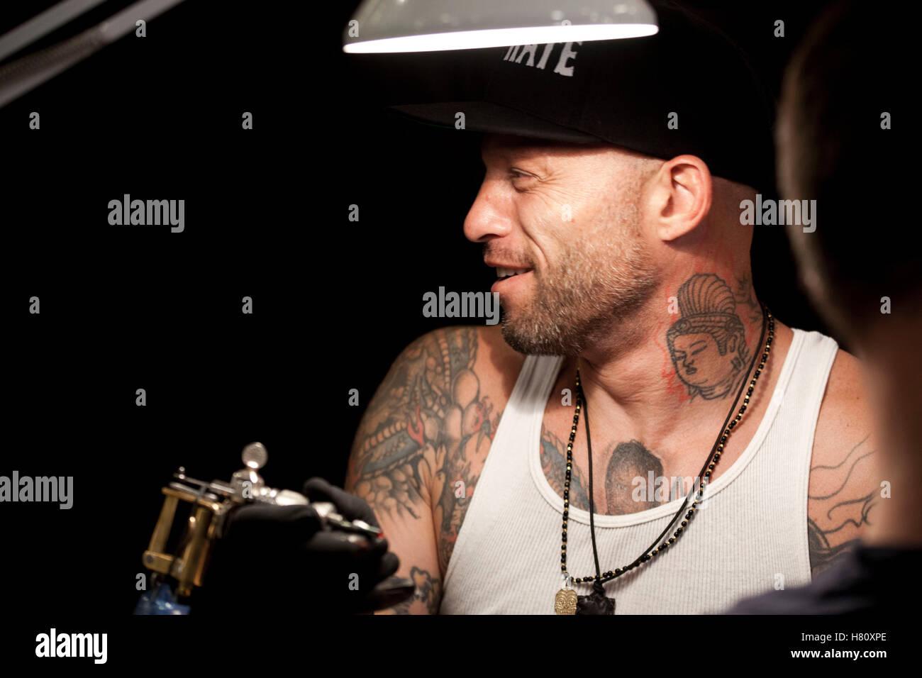 Tattoo artist Ami James attends the tattoo convention Copenhagen Ink 2013. - Stock Image