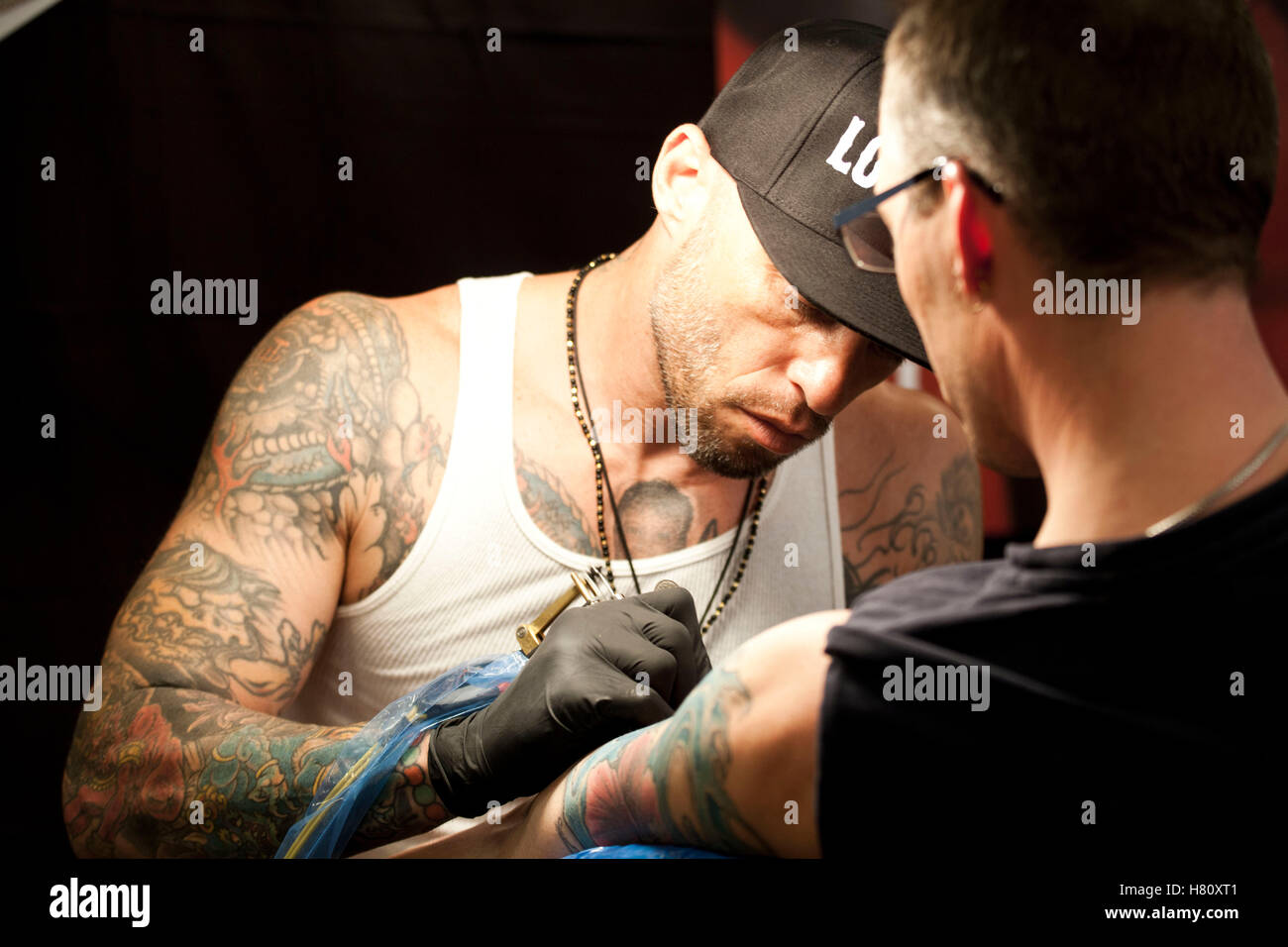 Tattoo artist Ami James attends the tattoo convention Copenhagen Ink 2013. Stock Photo