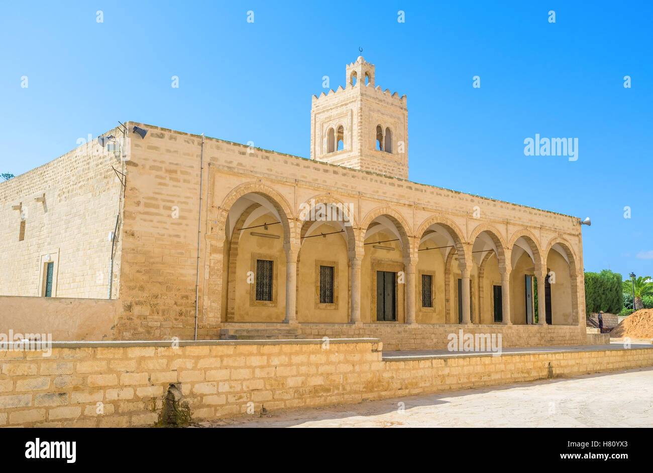The facade of the medieval Grand Mosque, that is neighboring with Ribat citadel, Monastir, Tunisia. - Stock Image