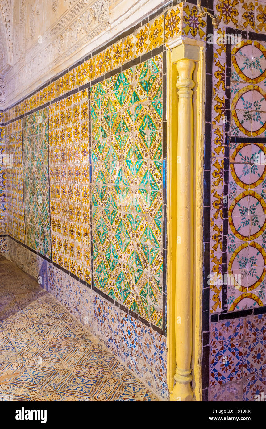 The walls in the vintage mansion covered with colorful glazed tiles ...