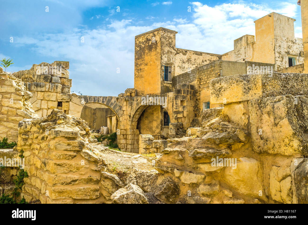 The ruins of the ancent  Roman baths among the residential neighborhoods of old El Kef, Tunisia. - Stock Image