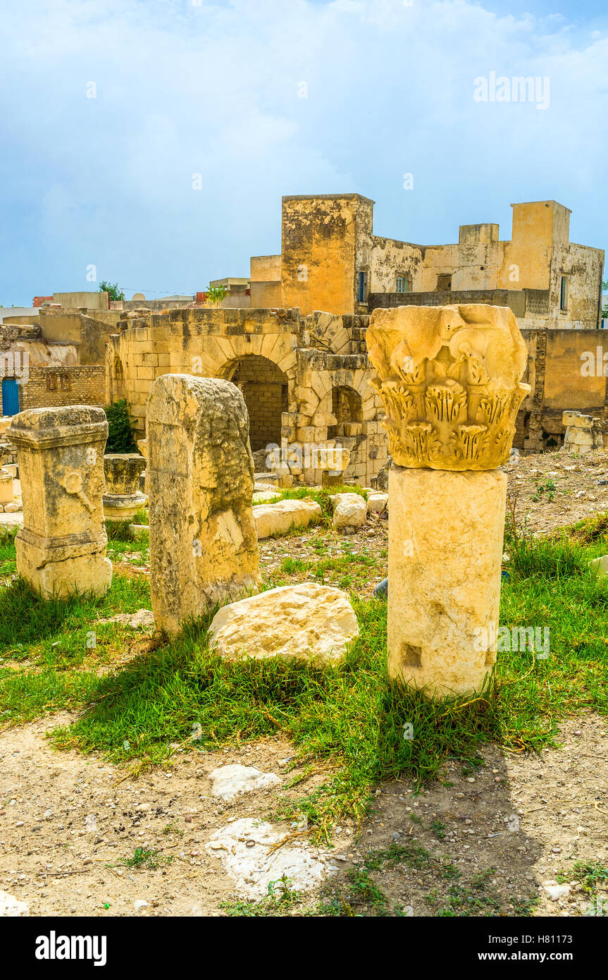 The ruins of the ancent columns decorated with carvings in archaeological site of the Roman baths, El Kef, Tunisia. - Stock Image