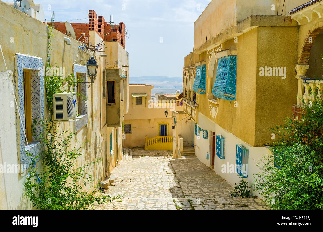 The old town of El Kef situated on the large hill, so its streets mostly are the climbs or the descents, Tunisia. - Stock Image