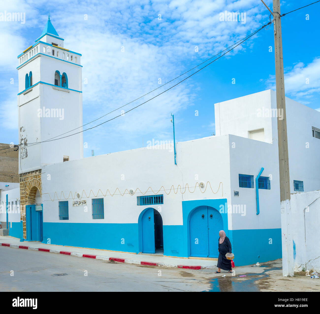 The blue-white building of the Andalusian Mosque located at the same named quarter next to the old cemetery - Stock Image