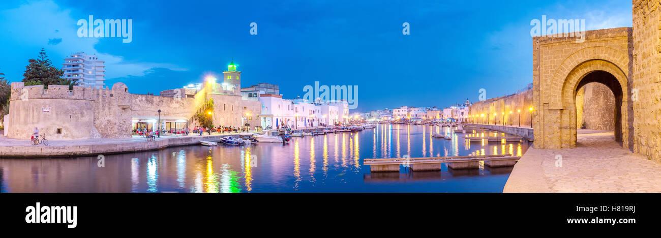 The bridge over the port overlooks to main landmarks of Bizerte - Kashbah and Ksibah citadels - Stock Image