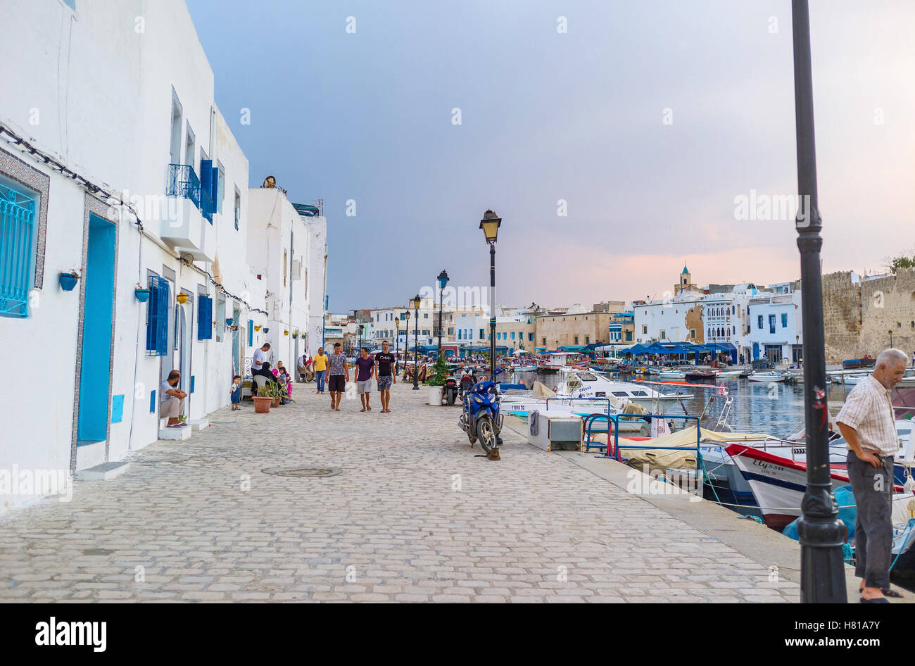The breezy evening is the best time to discover the old port of Bizerte - Stock Image