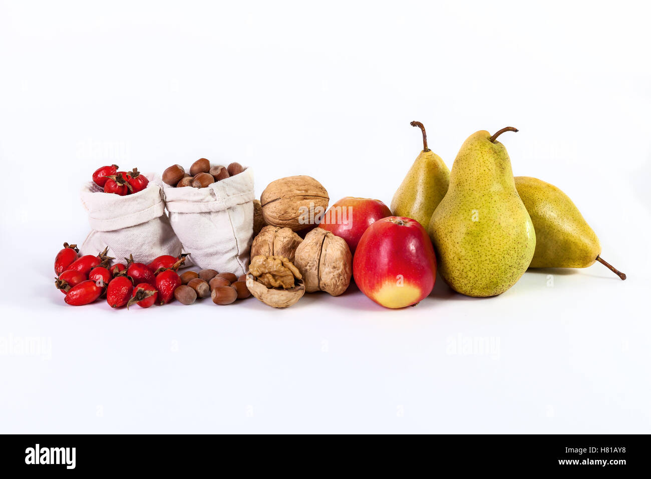 Autumn still life of fruit apples pears nuts rosehips isolated on white background Stock Photo