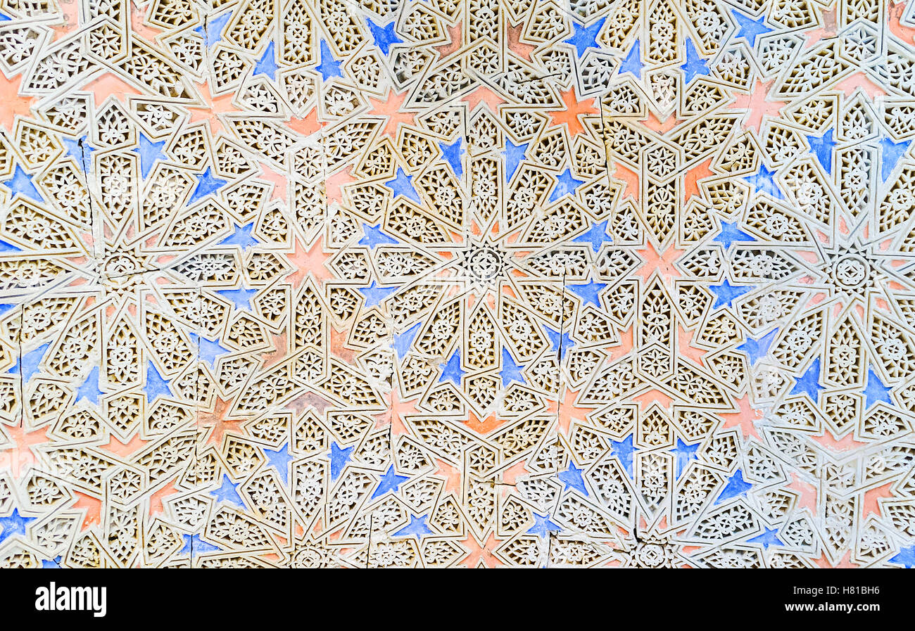The ganch carving with the colorful stellar patterns on the wall in Bardo National Museum in Hafsid Palace, Tunis - Stock Image