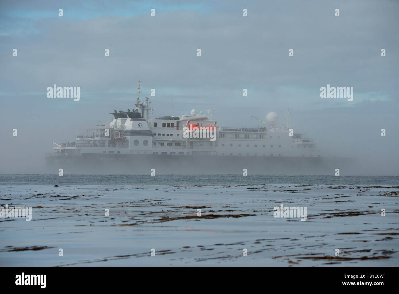 Russia, Kuril Islands, Yankicha Island. Silversea expedition ship, Silver Discoverer in the remote Kuril Islands. - Stock Image