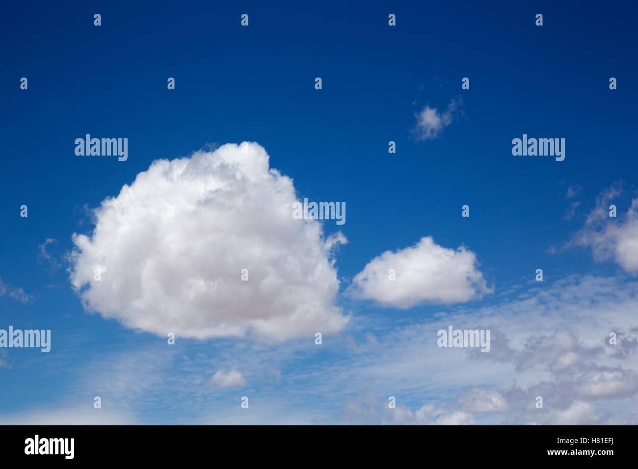 cumulus clouds against a blue sky - Stock Image