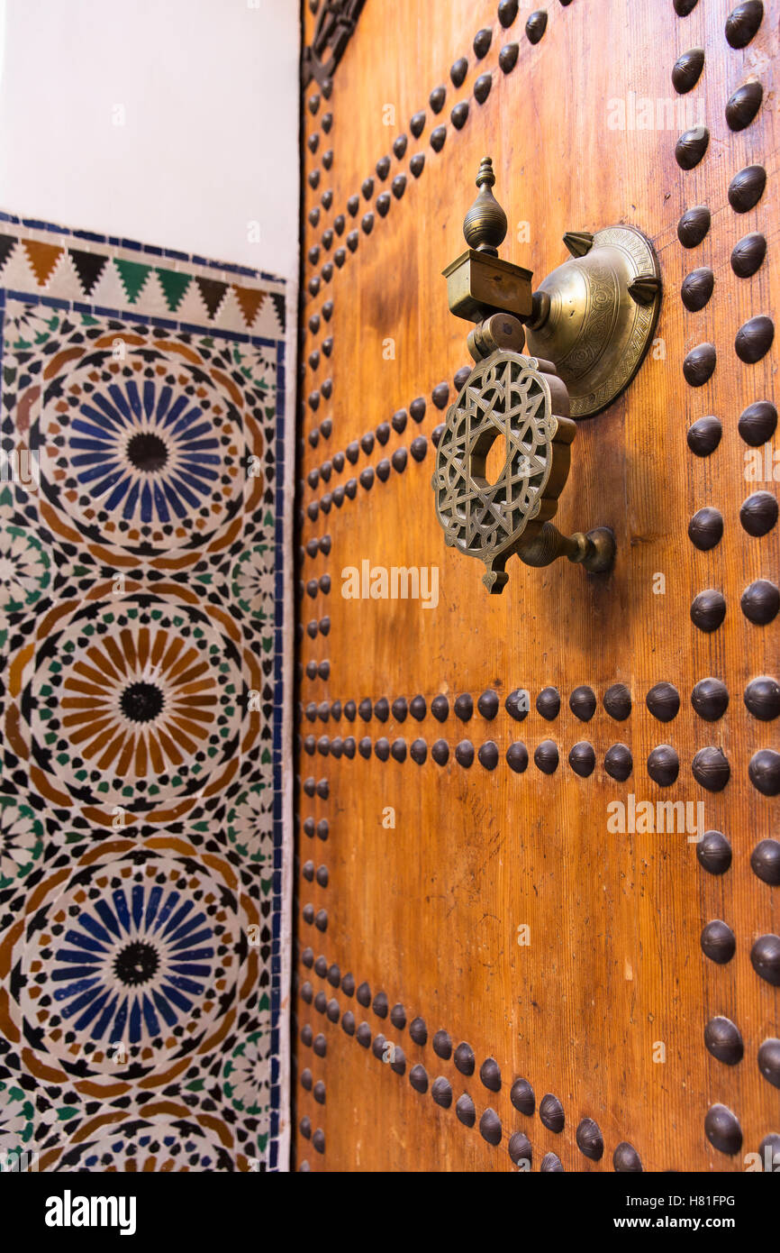 Morocco,Marrakesh,brass door knocker and tile work - Stock Image