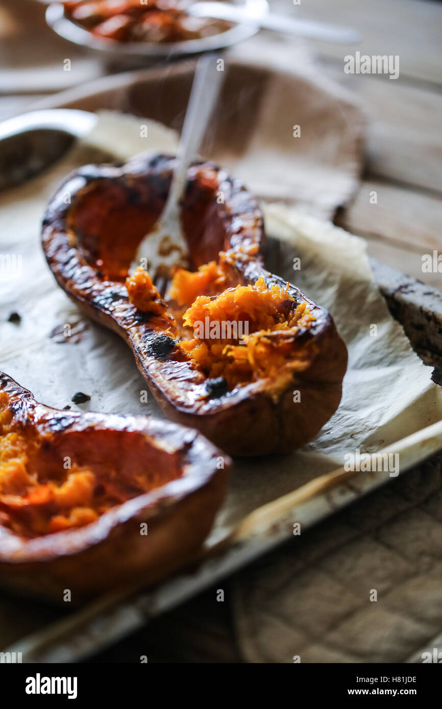 Stuffed butternut squash in a pan. - Stock Image