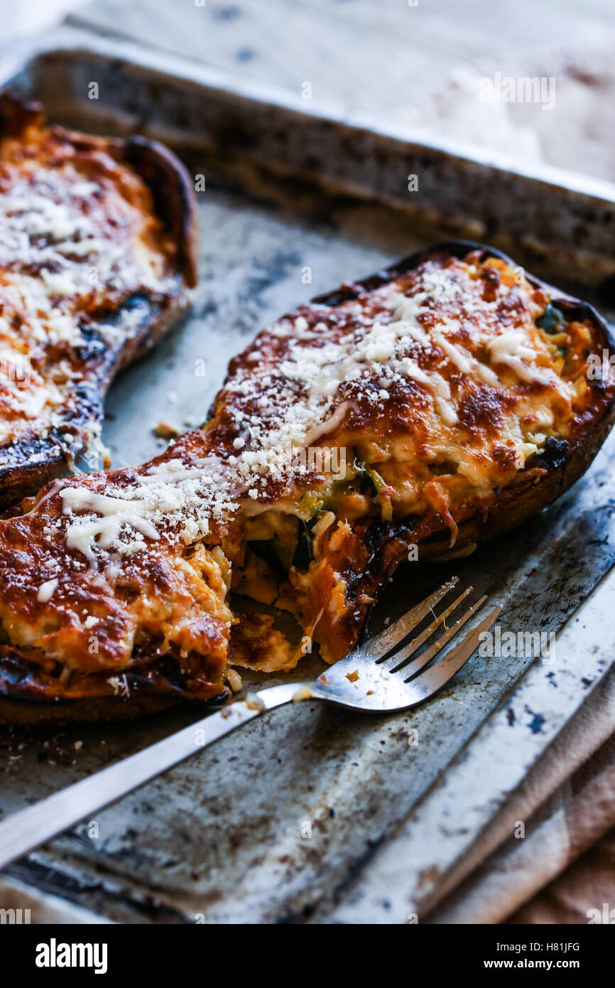 Rice and vegetables stuffed butternut squash in a pan. - Stock Image