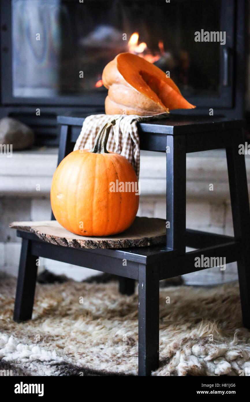 Pumpkin on a stool - Stock Image