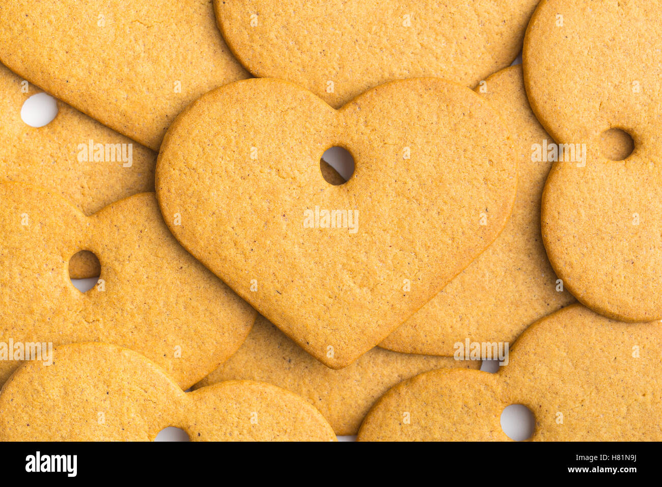 Tasty gingerbread hearts. Top view. - Stock Image