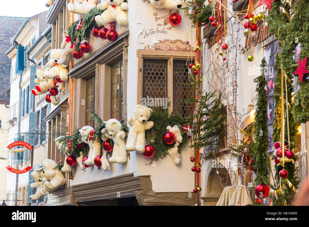 christmas decorations on typical historic half timbered restaurant in strasbourg wine route