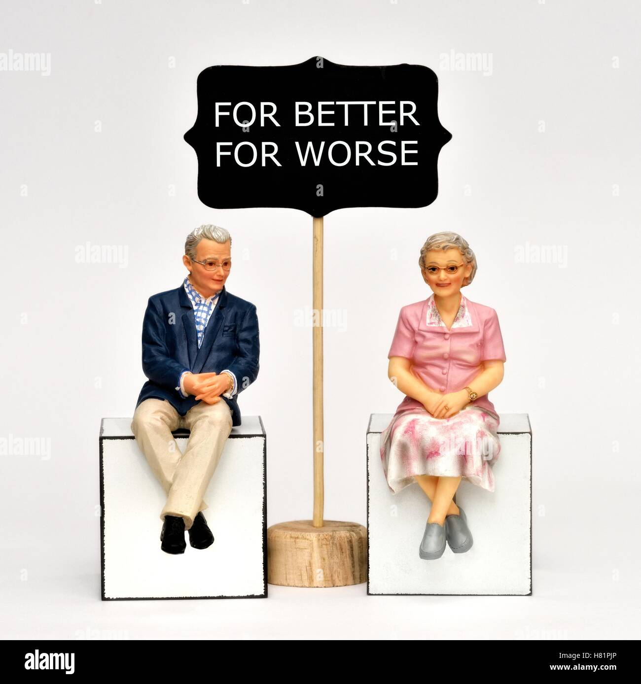 Two figurine pensioners for better for worse Stock Photo