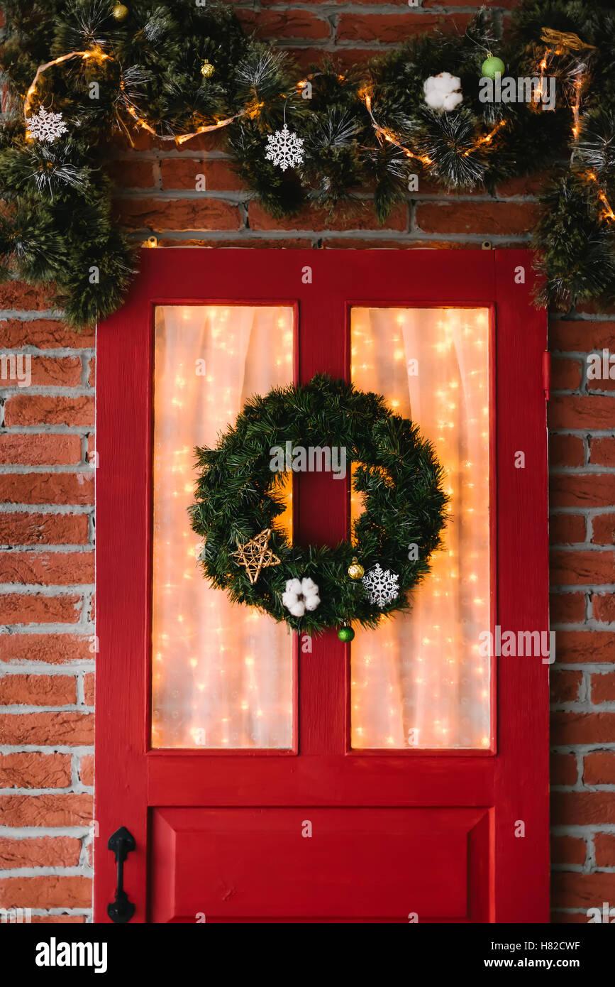 christmas wreath yellow door stock photos christmas. Black Bedroom Furniture Sets. Home Design Ideas