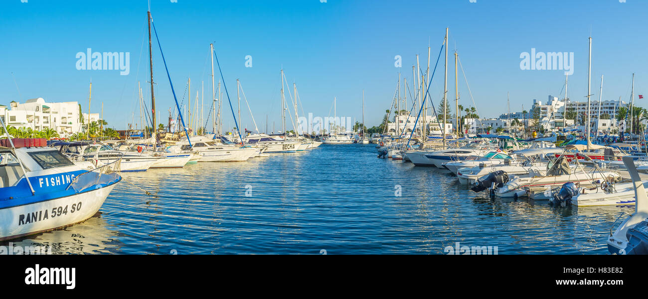 The port is full of small fishing boats, luxury yachts and tourist ships, Al Kantaoui, Tunisia - Stock Image