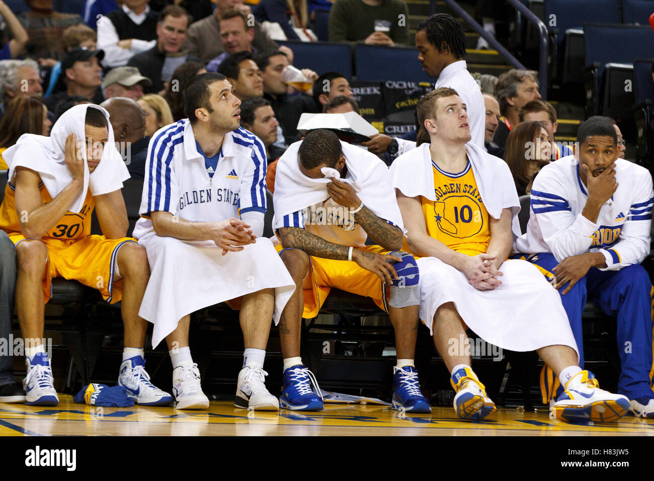 february-25-2011-oakland-ca-usa-golden-state-warriors-point-guard-stephen-curry-left-small-forward-vladimir-radmanovic-second-from-left