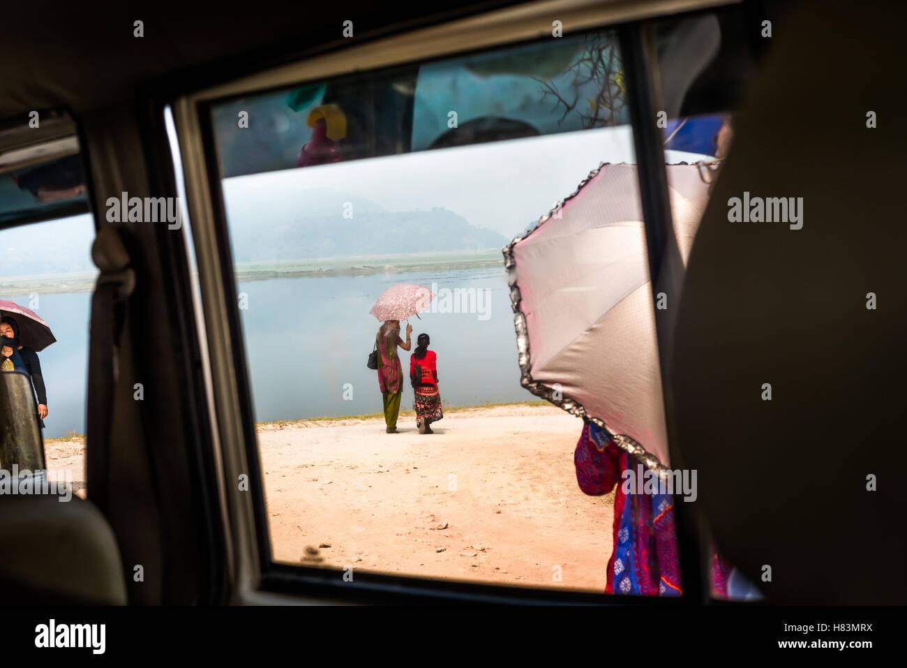 Local women walk near Phewa Lake in Kaski district, Nepal. © Reynold Sumayku - Stock Image
