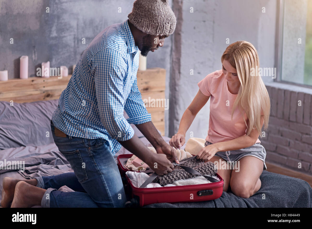 Concentrated couple preparing for a vacation - Stock Image