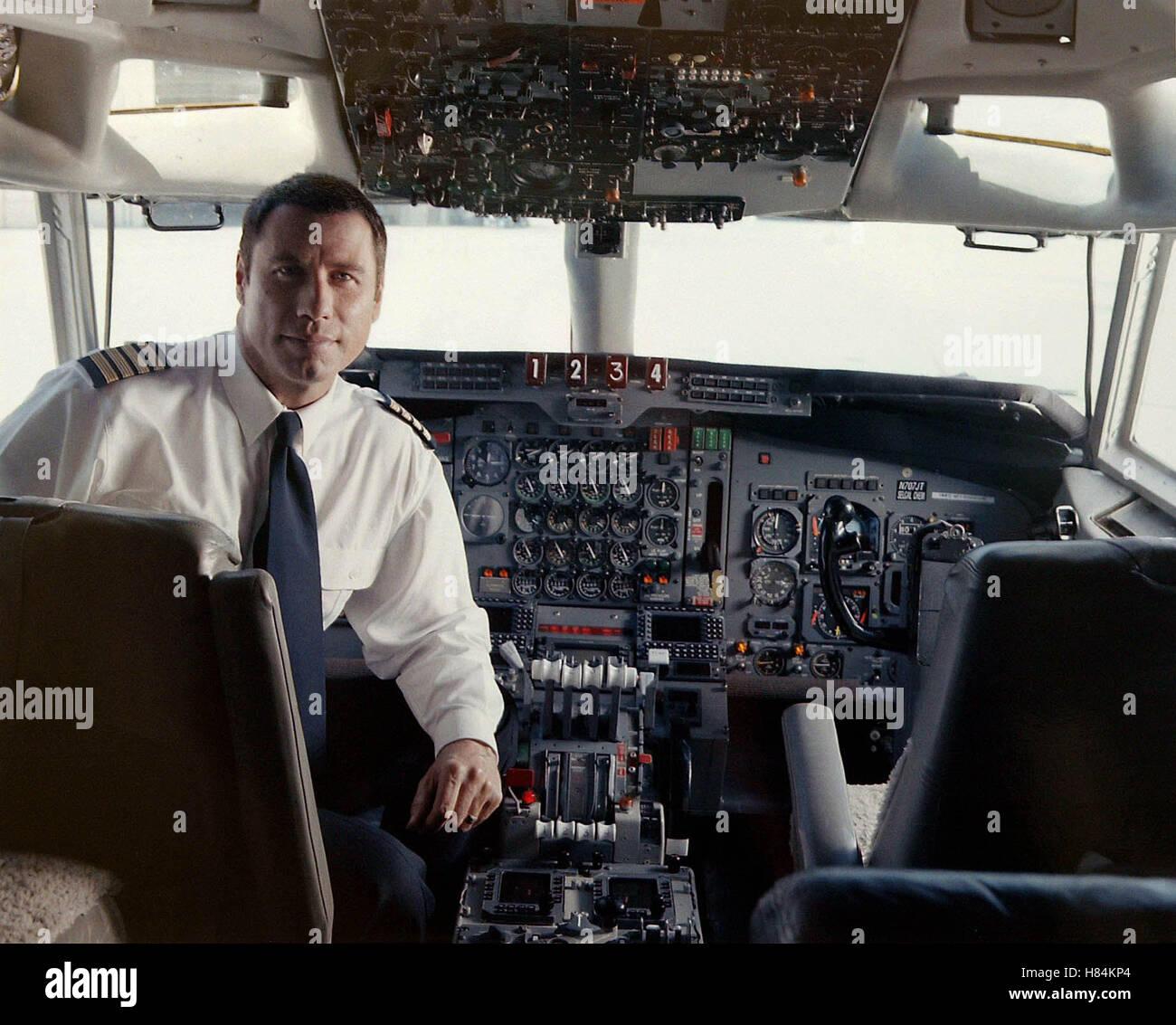 JOHN TRAVOLTA PUBLICITY SHOT QANTAS AMMASSADOR AT LARGE LOS ANGELES AIRPORT [LAX] LOS ANGELES USA 24 June 2002 - Stock Image