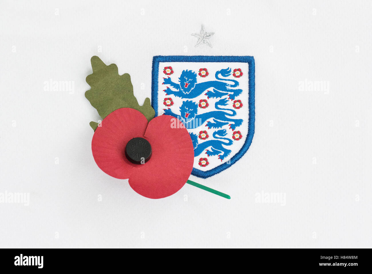 FIFA has banned players from England and Scotland from wearing poppies on their kits during their clash on November - Stock Image