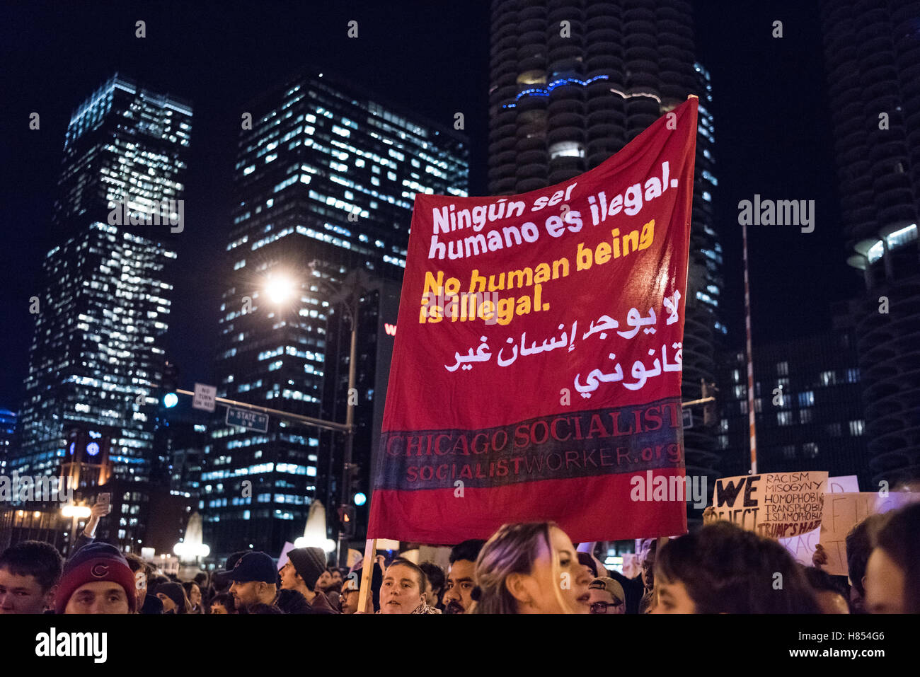 Chicago, Illinois, USA. 9th November, 2016. Chicago Socialists hold a sign reading 'No Human Being is illegal' - Stock Image
