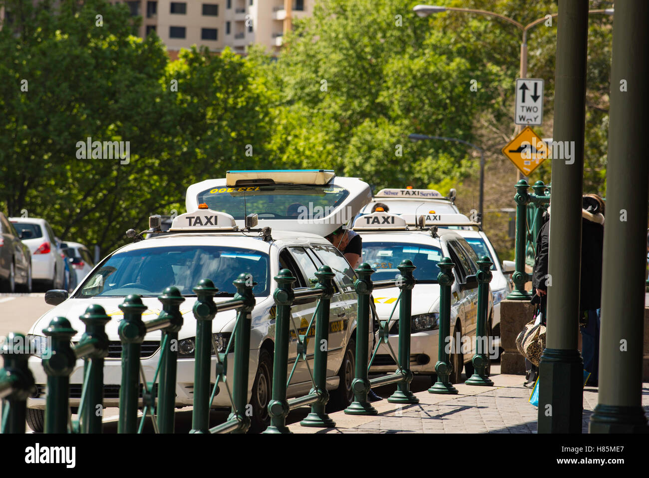 Taxi cabs standing in a rank waiting for work at Sydney's Central Railway Station - Stock Image