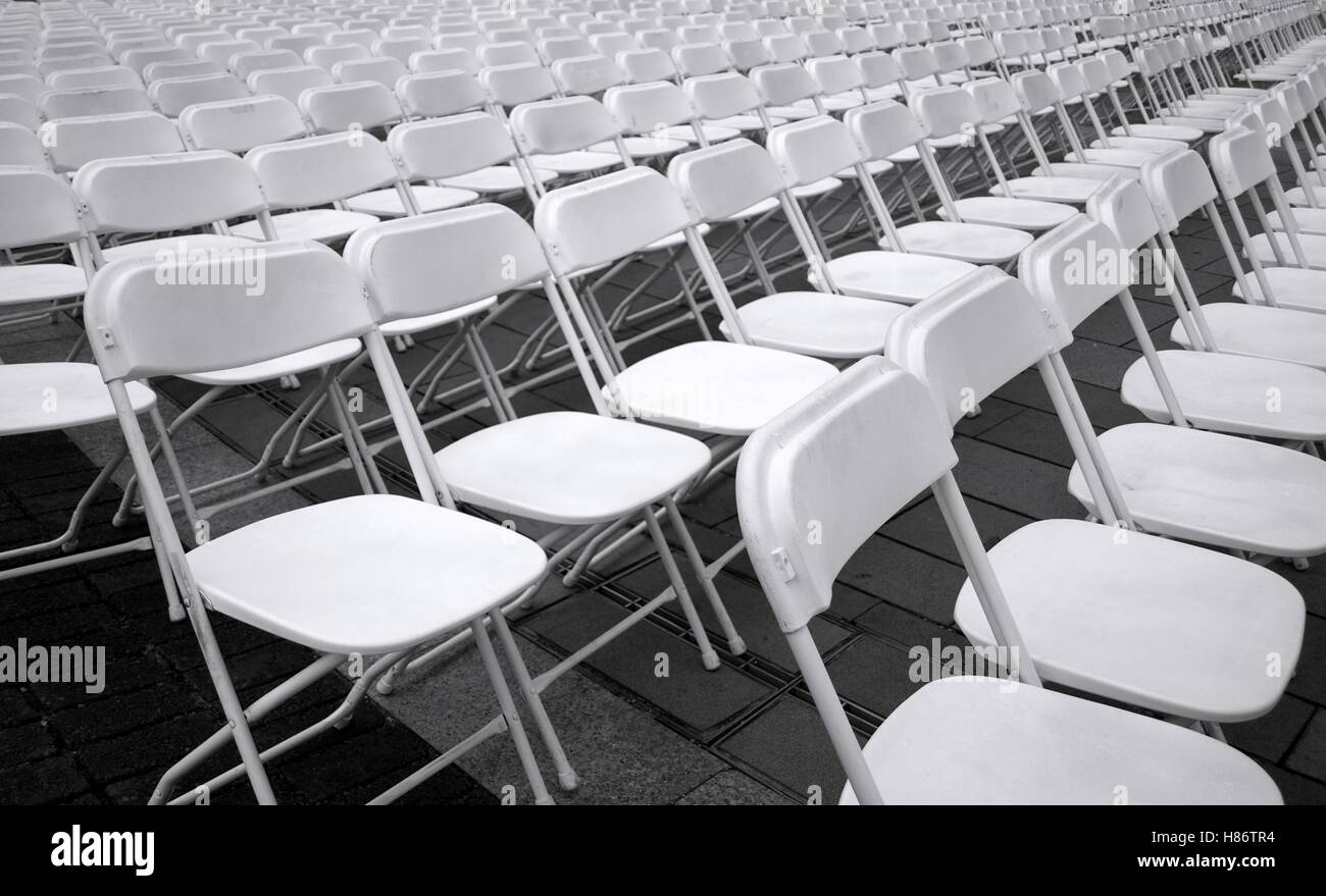 Plastic folding chairs are set up for an outdoor concert & Plastic folding chairs are set up for an outdoor concert Stock Photo ...