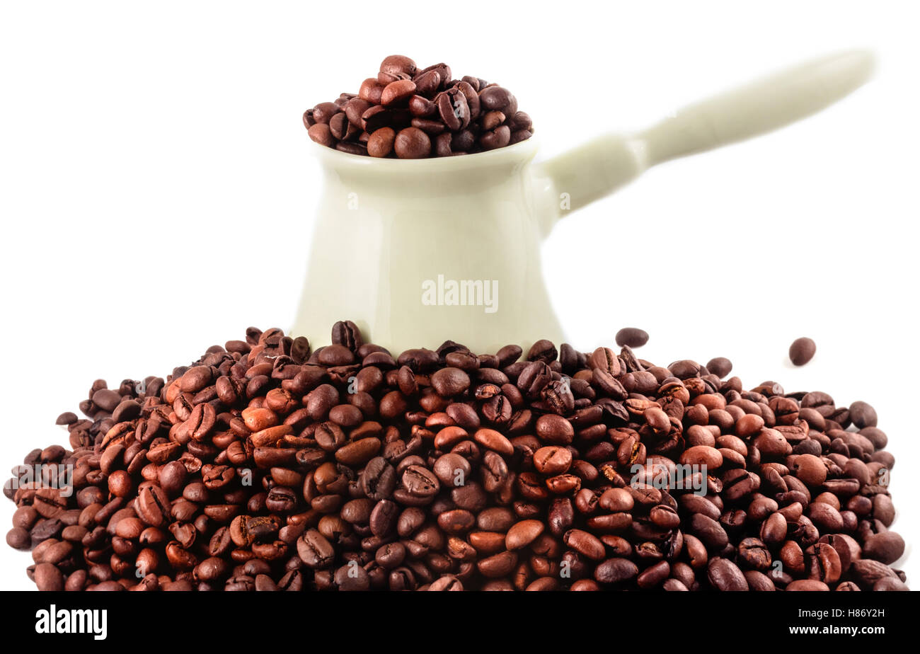 Porcelain coffee turk and coffee beans isolated - Stock Image
