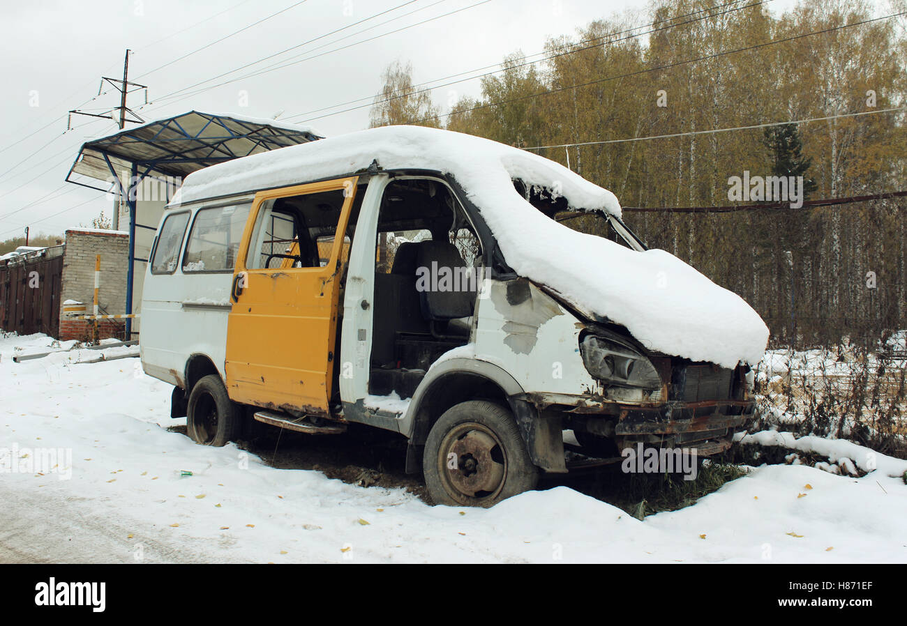 Disassembled car after the accident under the snow - Stock Image