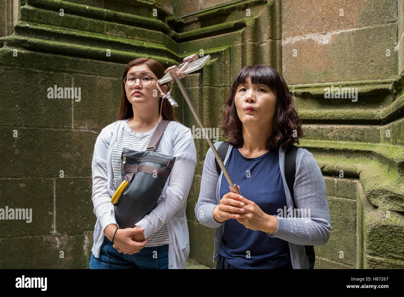 chinese tourist tourists take selfie funny face Stock Photo