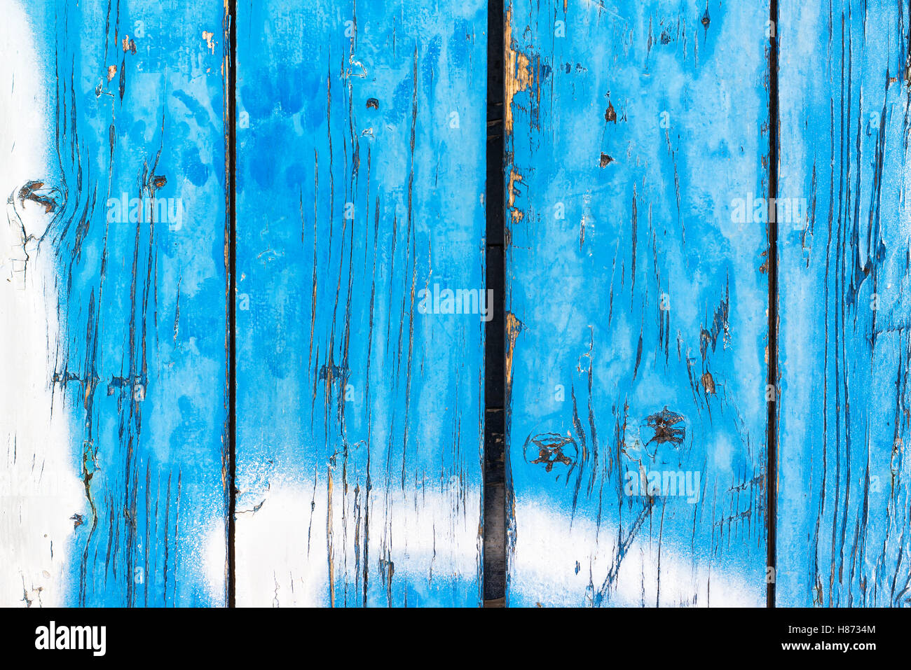 Rustic wooden texture, blue painted planks peeling off - Stock Image