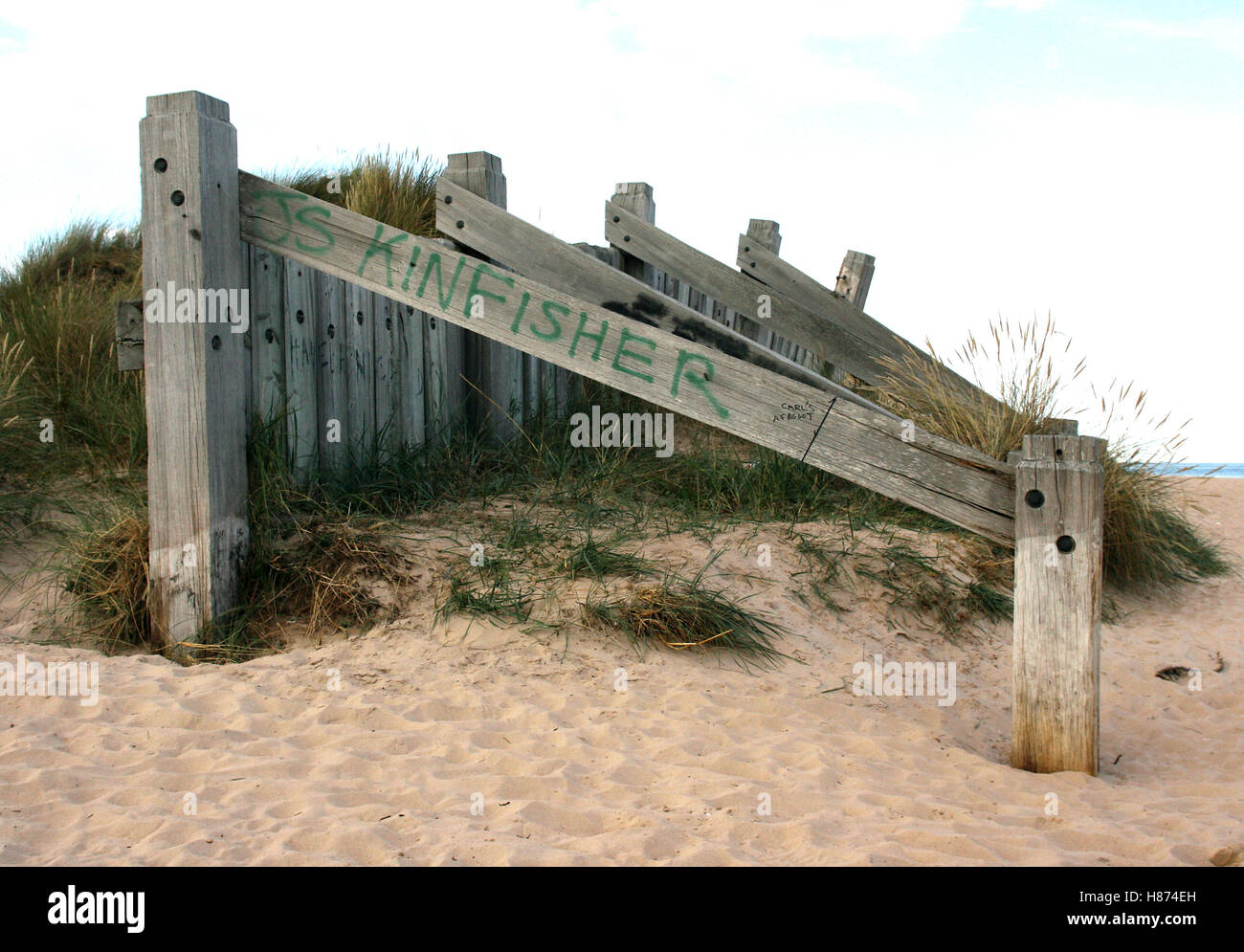 Graffiti marked sand dune defences built on the beach at Kinloss, North East Scotland to minimise North Sea wind - Stock Image