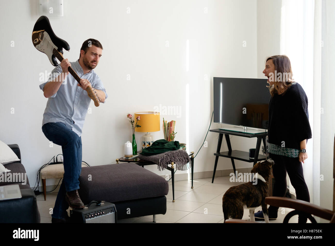 Man and woman living together and having a big quarrel - Stock Image