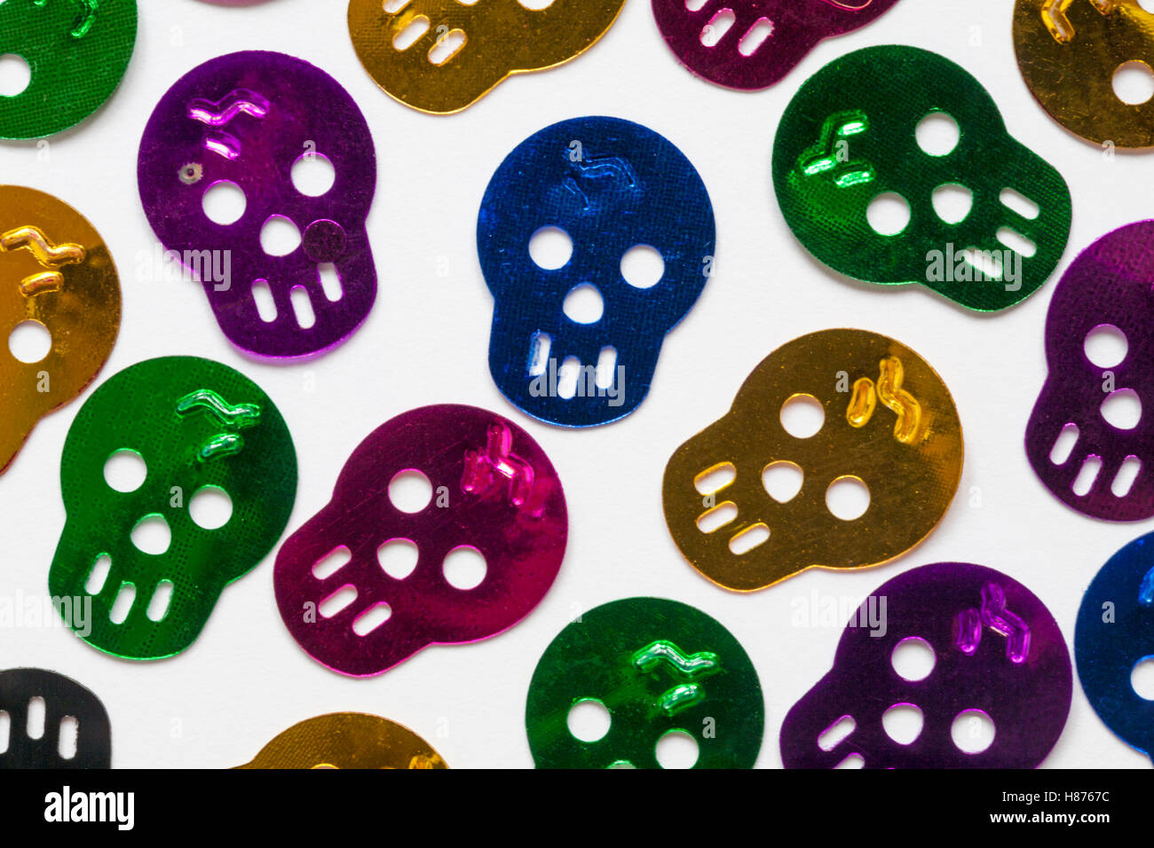 Halloween Mystical Confetti - skulls spread out on white background - Stock Image