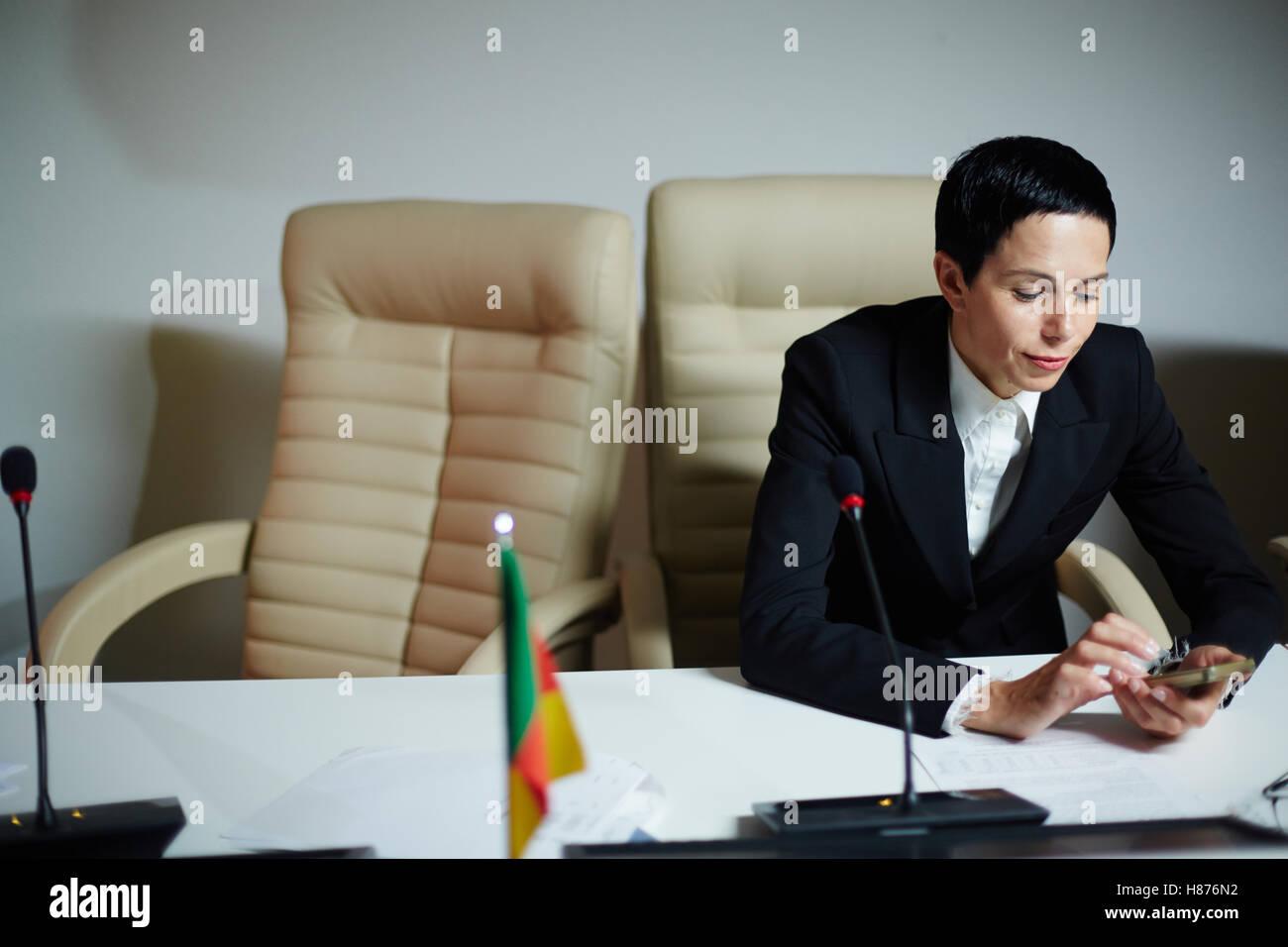 Female delegate on break - Stock Image