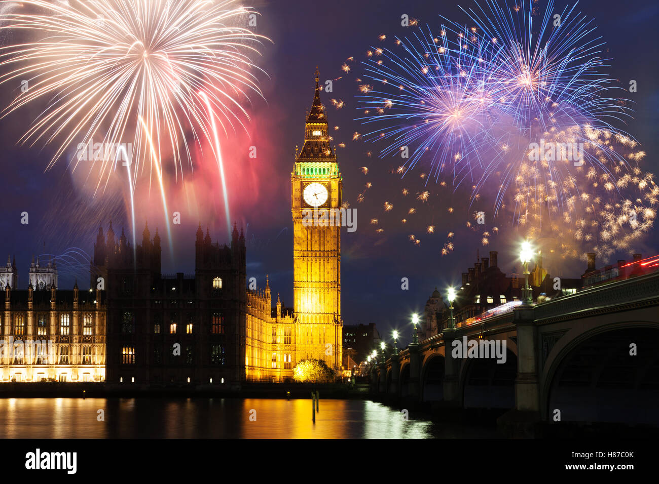 explosive fireworks display around big ben new years eve in the city celebration background