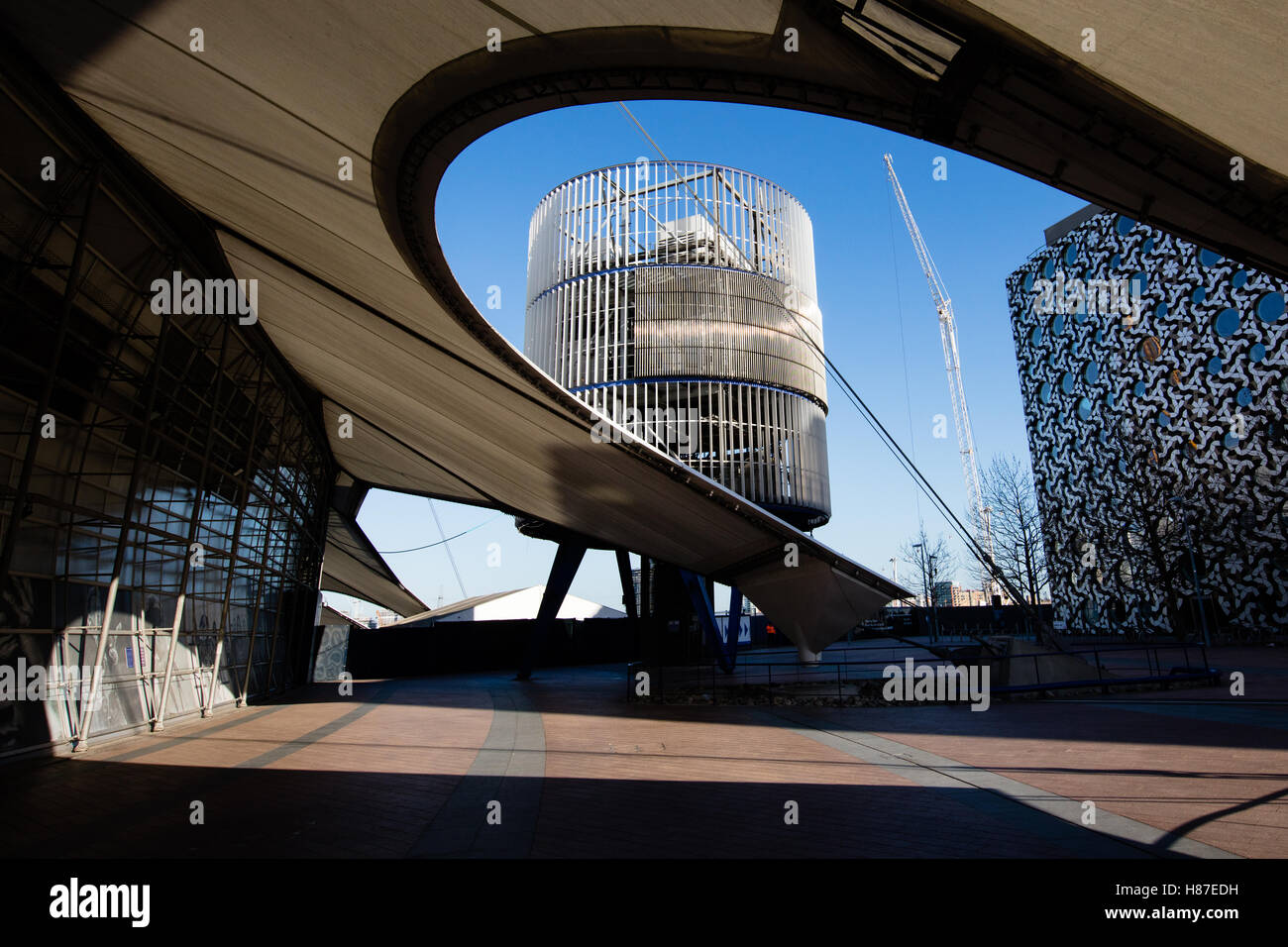 Under the outer skirts of the O2 arena Millenium Dome at North Greenwich in London with one of the twelve outer - Stock Image