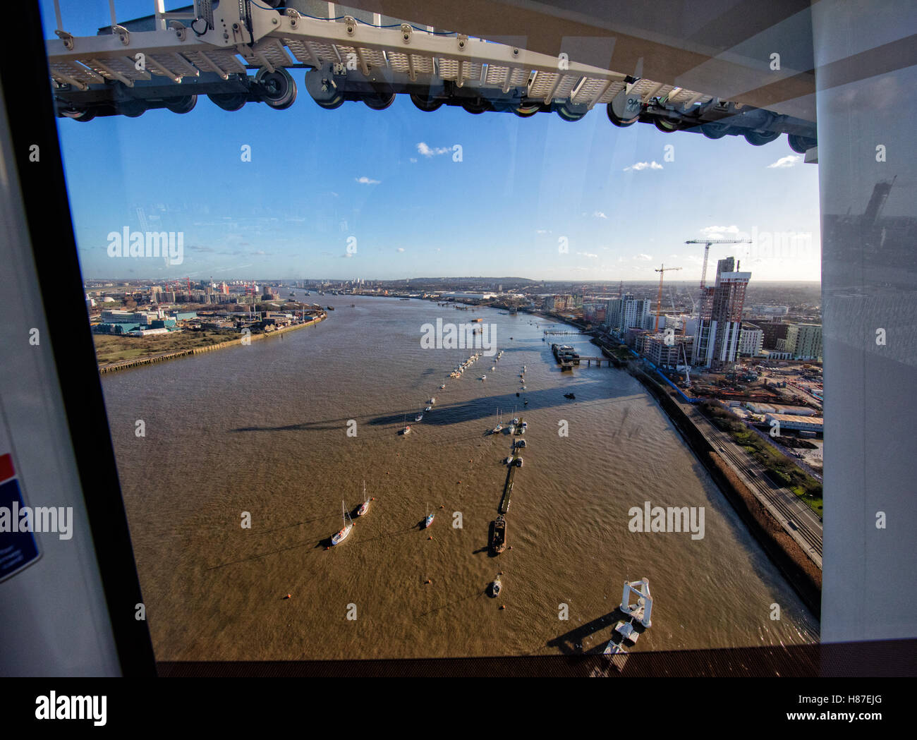 Emirates Air Line gondola cable car across the River Thames from the Greenwich peninsula to the Royal Victoria Dock - Stock Image
