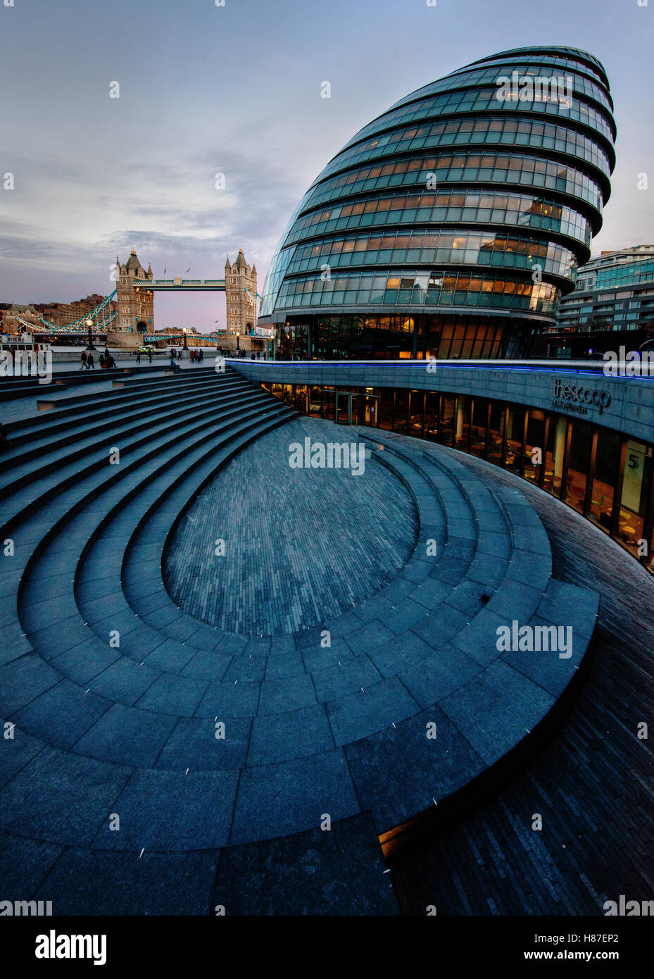 City Hall near Tower Bridge - home to the Mayor of London the Greater London Authority and London Assembly at dusk - Stock Image