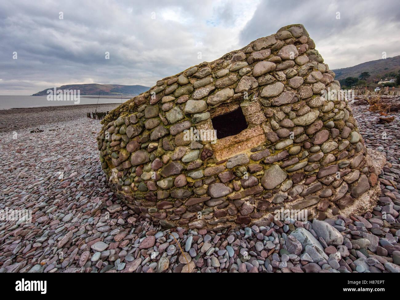 World War II pillbox at Porlock Weir built of and on coarse shingle beach - Somerset Exmoor UK - Stock Image