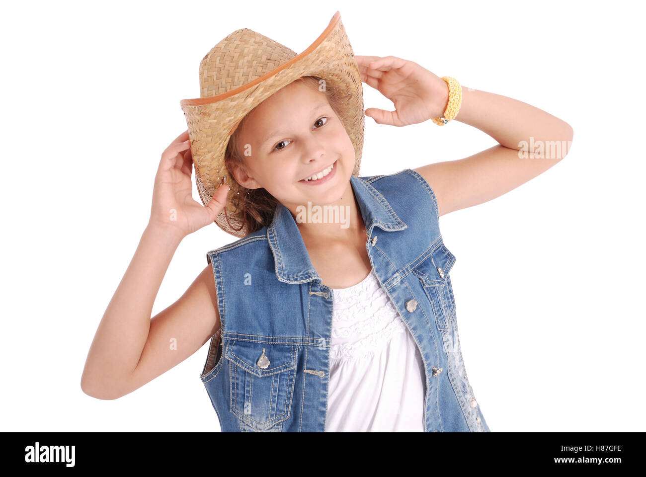 Pretty twelve year old girls wearing a big floppy straw sun hat isolated on white Stock Photo