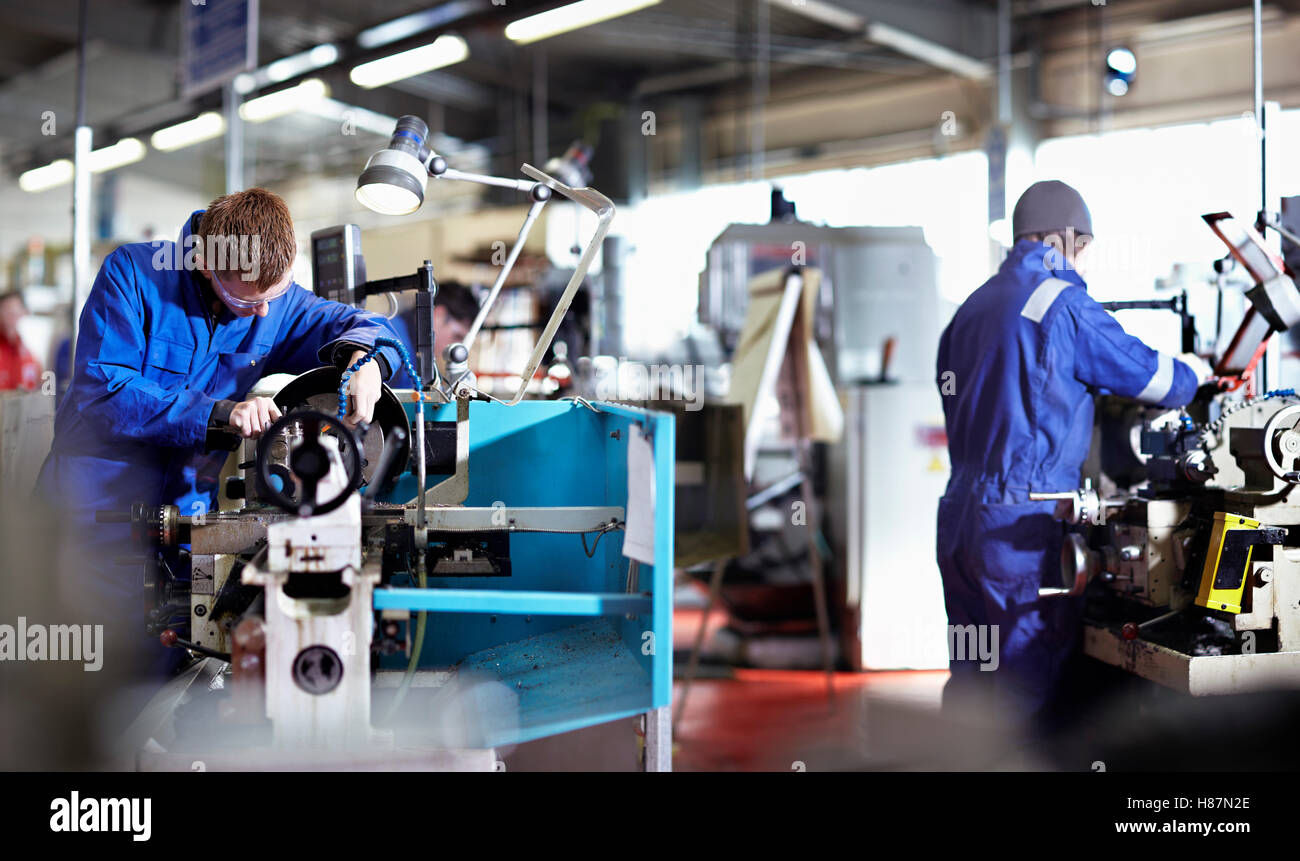 Two young Engineers working on metal Lathes. Northern Powerhouse Stock Photo