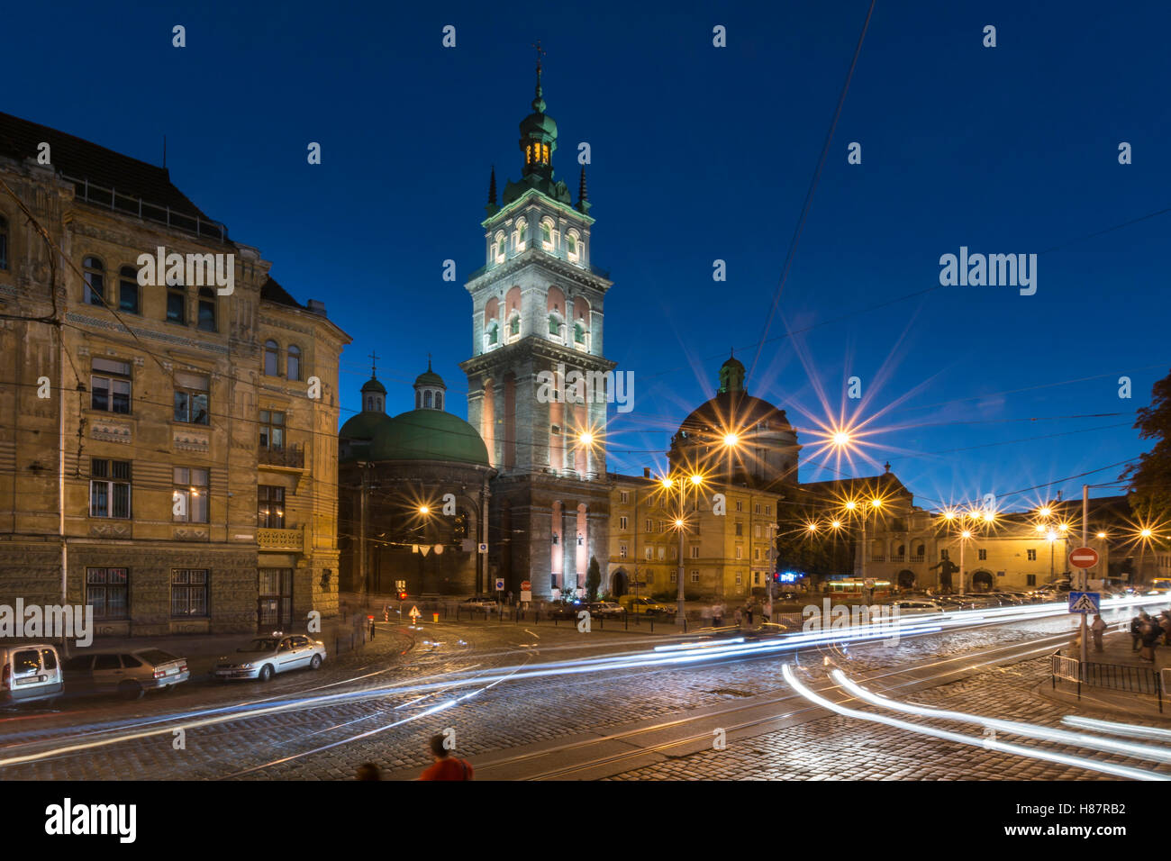 View of Old Town and the Virgin Mary's Assumption Church Bell Tower at blue hour in Lviv,Ukraine - Stock Image