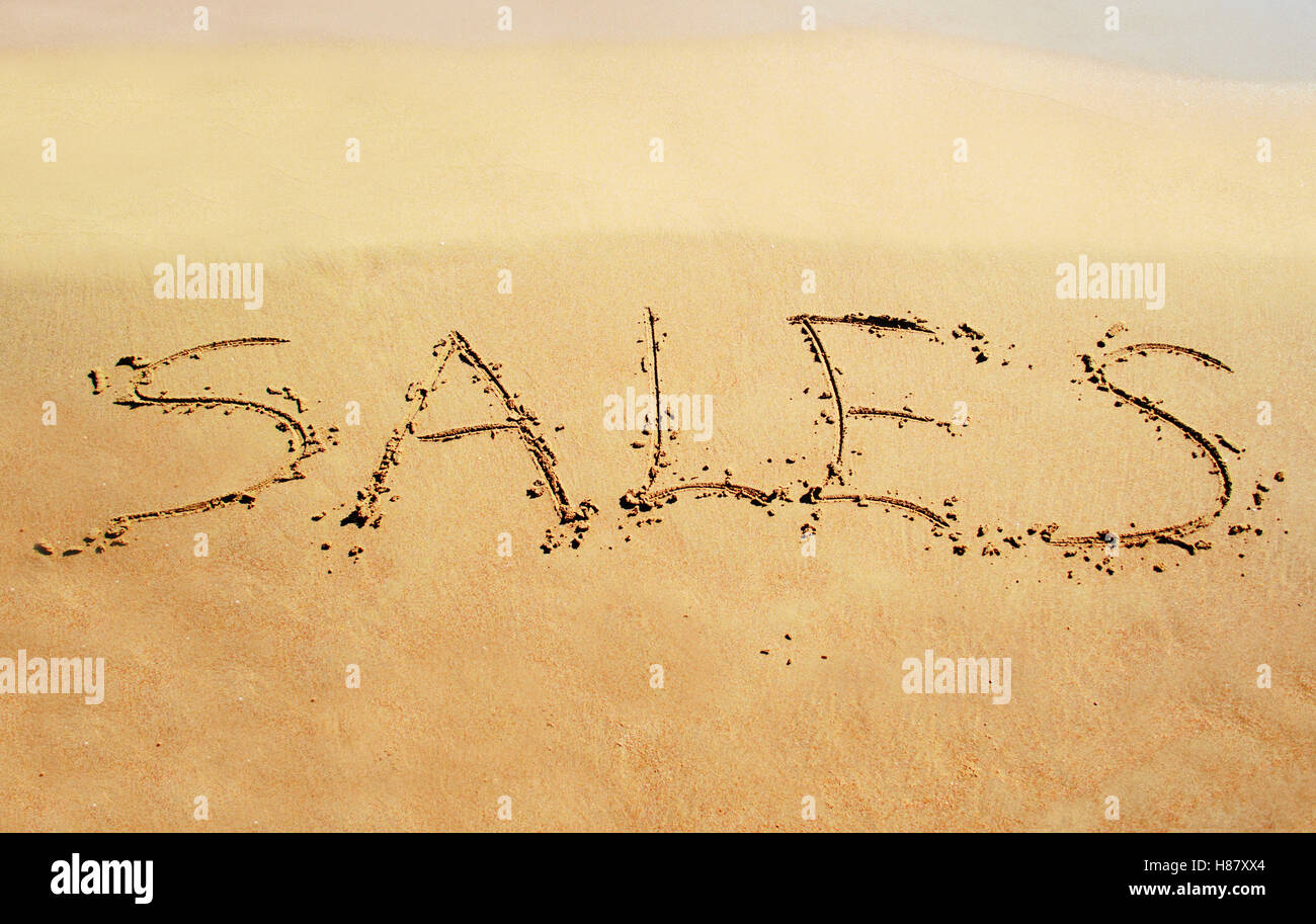sale note written on the sand - Stock Image