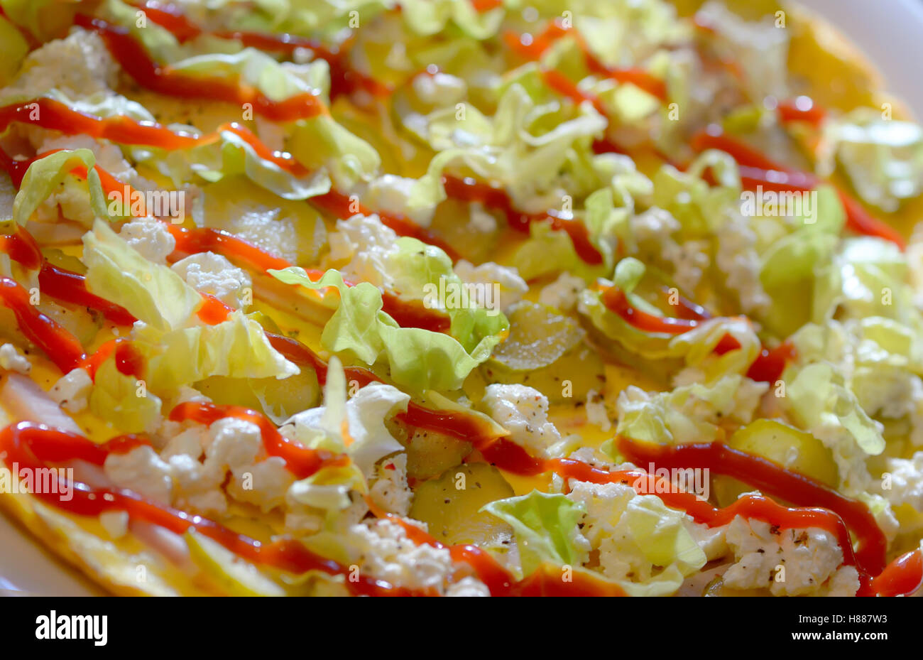 Ham and cheese omelet with vegetables - Stock Image